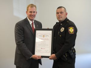 President Ryan Smith presents Officer Richard Harrison with the 'Larry and Laura Rees Certificate of Excellence Award' for being named the University of Rio Grande Campus Police Department 'Officer of the Year'.